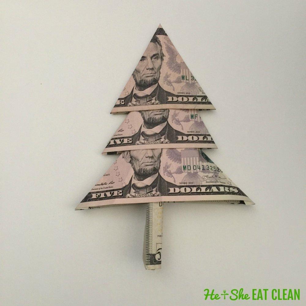 3 five dollar bills folded to make a Christmas money tree step 7