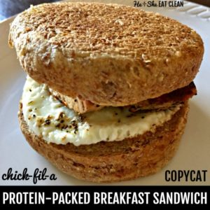 breakfast sandwich on a white plate with text that reads chick fil a copycat protein packed breakfast sandwich