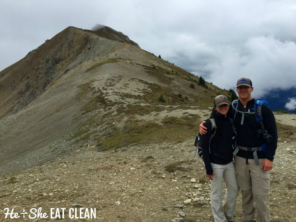 landscape photo of male and female hiker on the Kindersley/Sinclair Loop in Kootenay National Park on top of a mountain