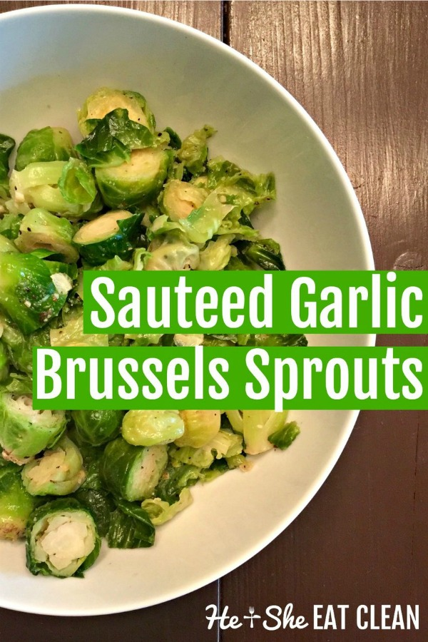 Sautéed Garlic Brussels Sprouts in a white bowl on a wooden table