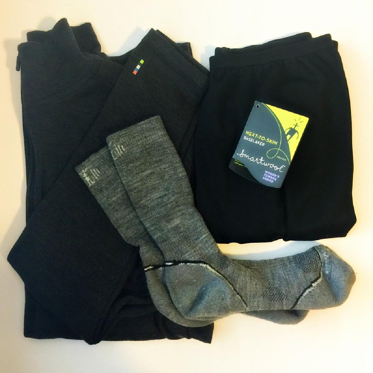 overhead shot of smartwool baselayers: shirt, pants, and socks