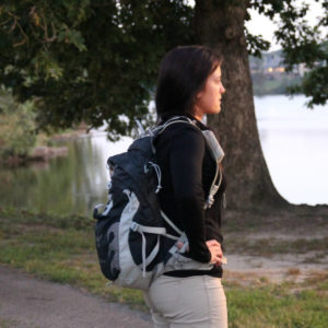 female looking into the distance wearing a hiking pack