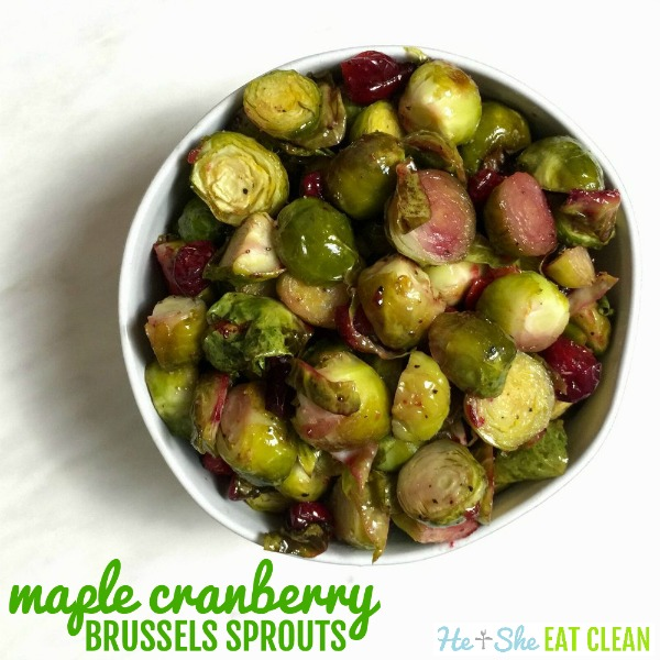 Maple Cranberry Brussels Sprouts in a white bowl on a white background