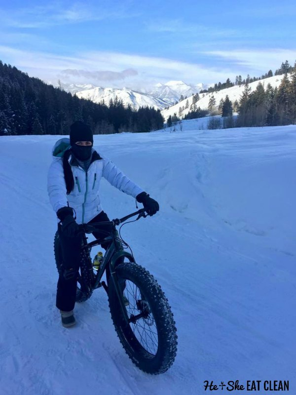 female standing next to a fat tire bike in Jackson, Wyoming