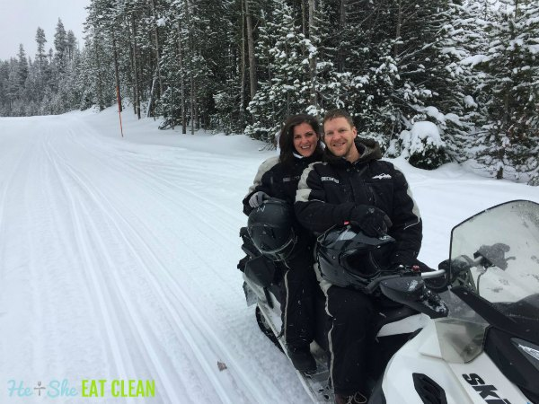 male and female on a snowmobile in Yellowstone National Park