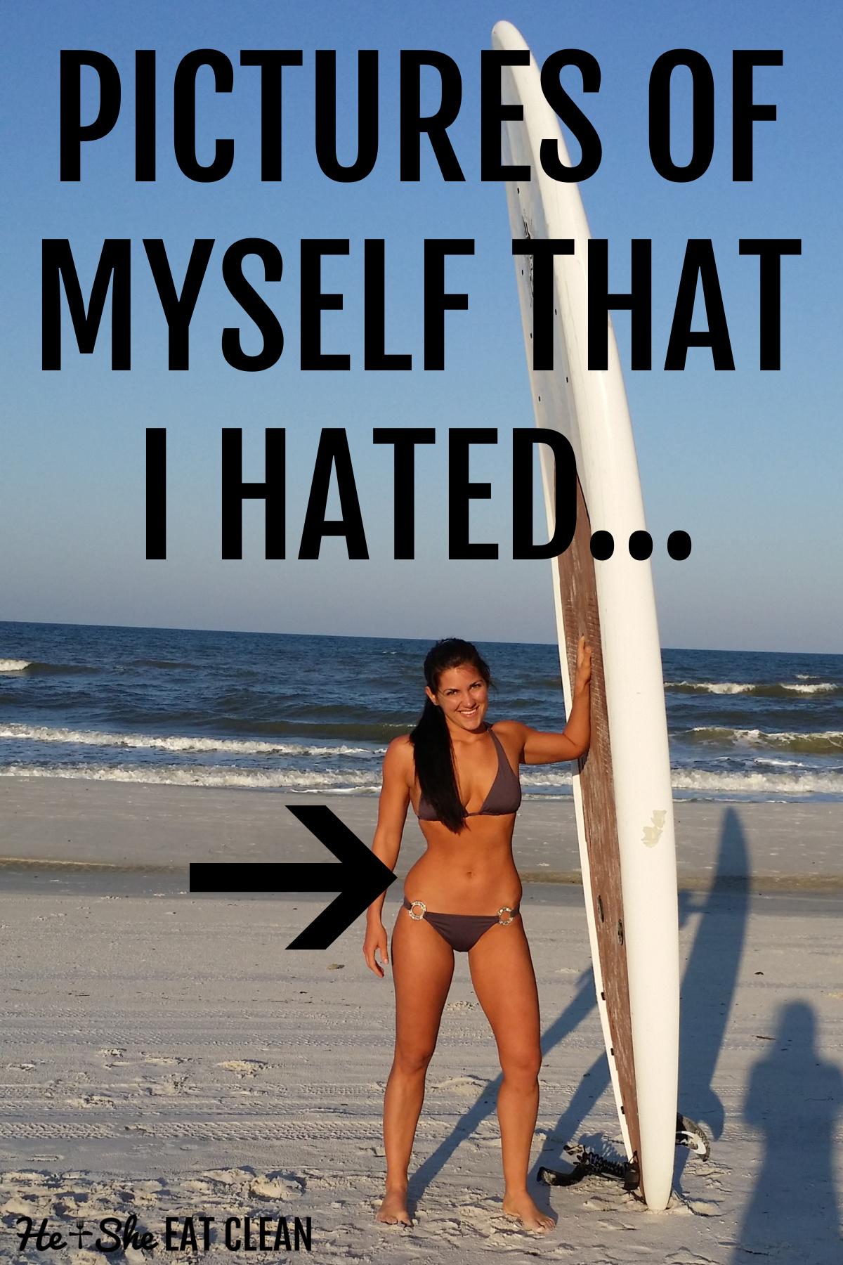 female standing next to a paddleboard in a dark purple bikini