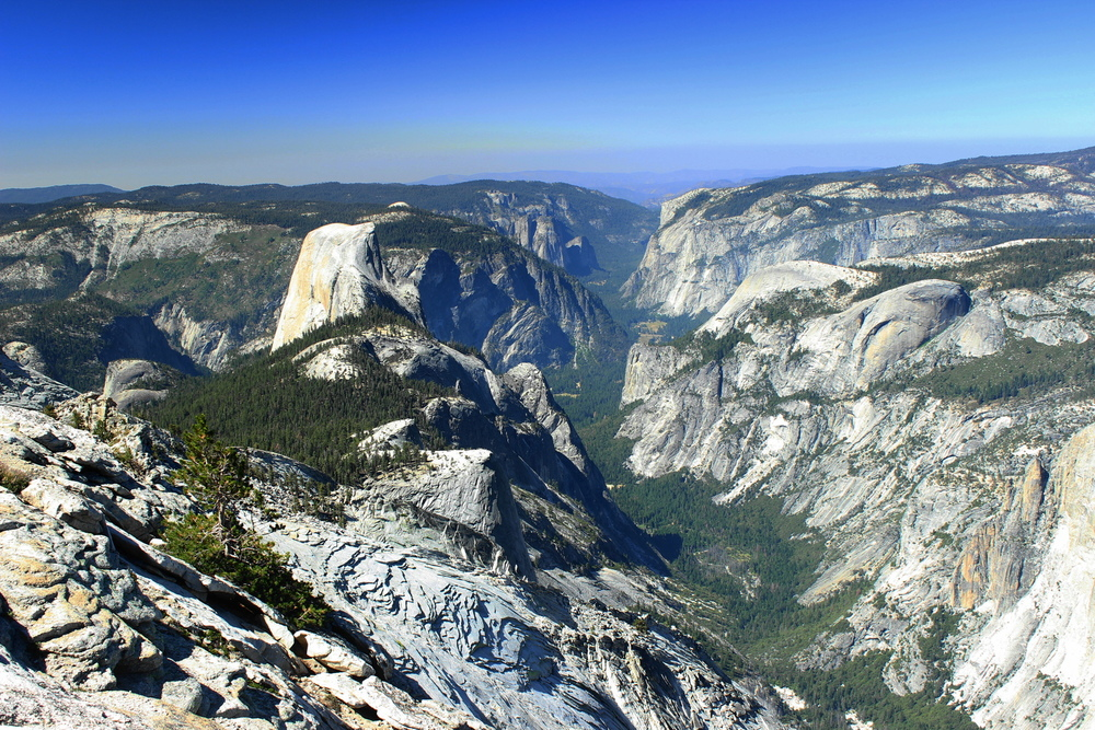 The awe-inspiring view of Yosemite Valley from Clouds Rest with Half Dome on the left and El Capitan on the far right.