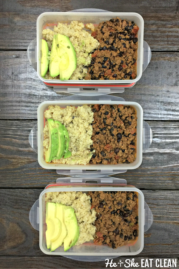 bison chili and quinoa with sliced avocado portioned out in containers on a wooden table