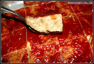 close up of meatloaf with ketchup on top on a fork