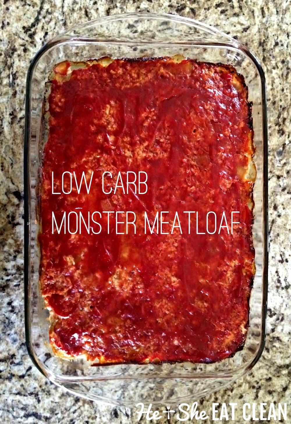 meatloaf with ketchup on top in a glass dish on a granite countertop