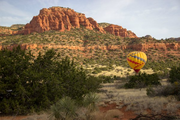 red rocks of Sedona, Arizona with a hot air balloon landing