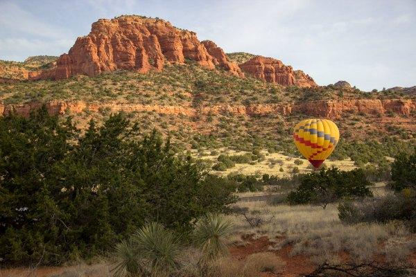 red rocks of Sedona, Arizona with a hot air balloon landing
