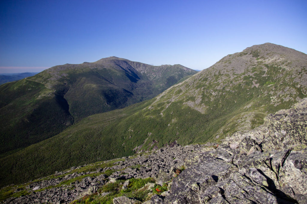 mountain range covered in rocks and green crush in the White Mountains of New Hampshire