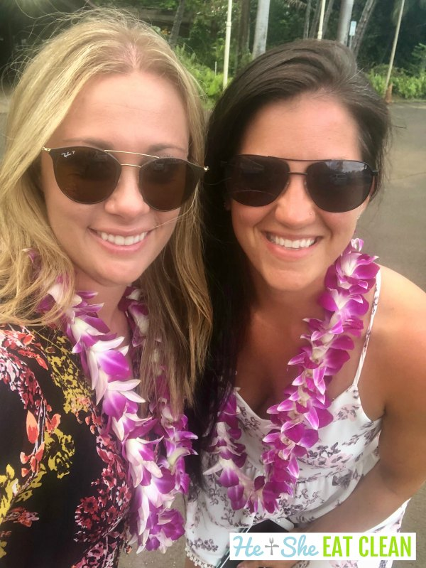 two females wearing pink leis from Costco in Kauai, Hawaii