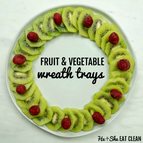 kiwi and raspberries arranges in a wreath on a white plate with the words fruit & vegetable wreath trays