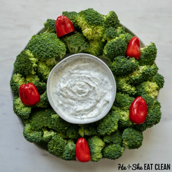vegetable tray with broccoli and red peppers made into a wreath