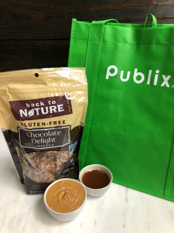 bag of Back to Nature granola behind a dish of peanut butter and honey in front of a green Publix bag
