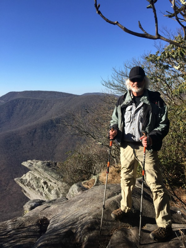 man standing on top of a rock on the Pickens Nose hike in North Carolina