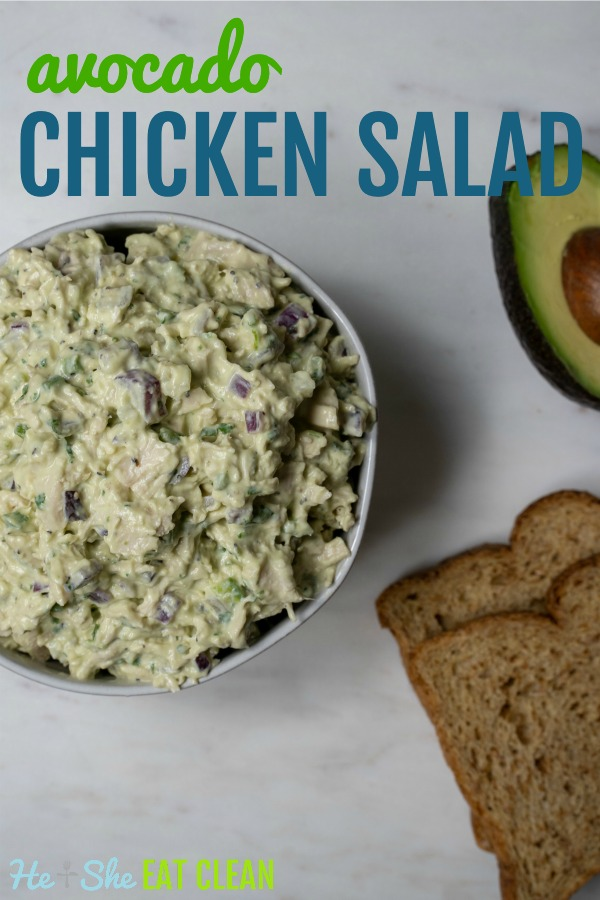 bowl of avocado chicken salad with toast and avocado on the side