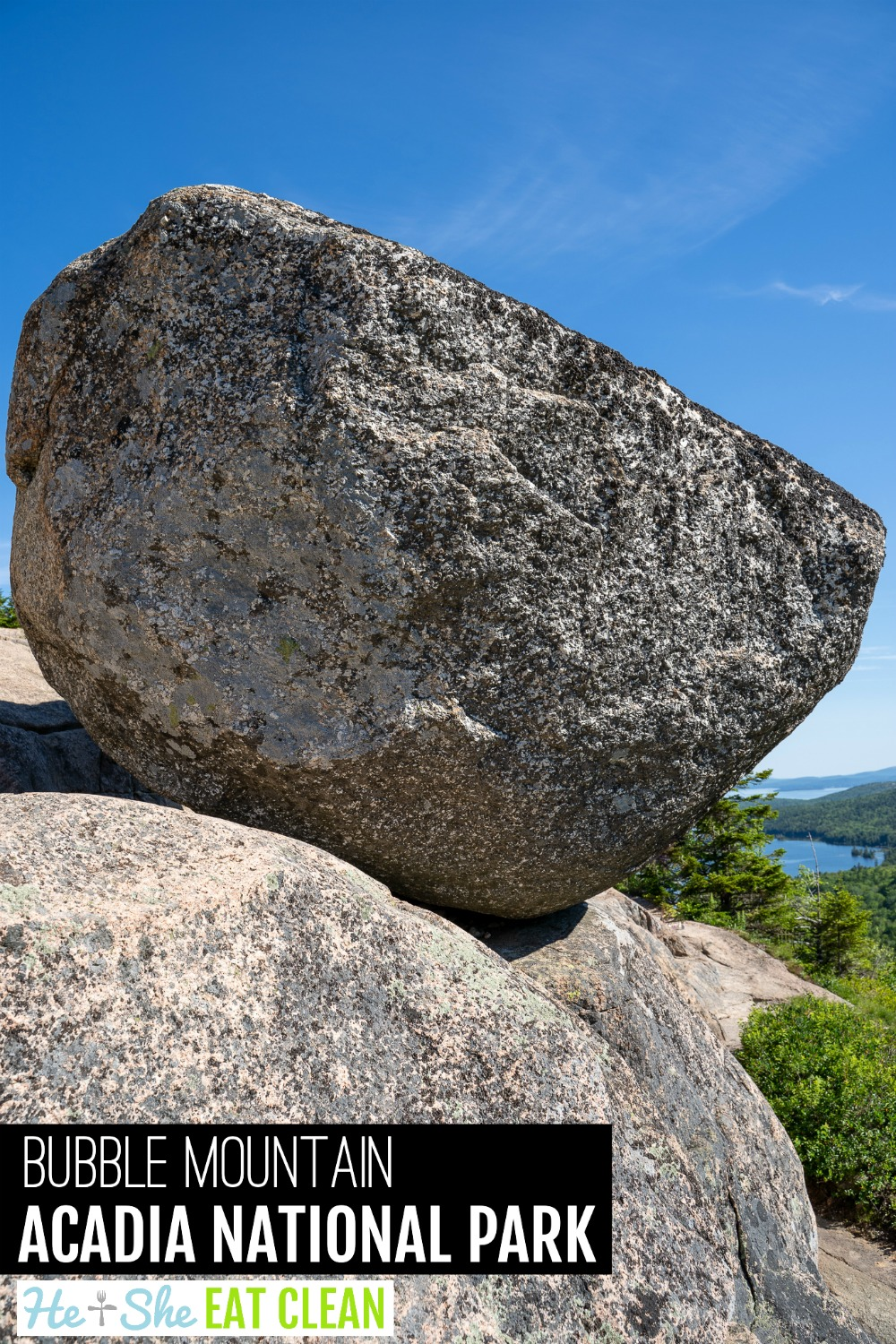 large rock on the side of a mountain in Acadia National Park with Jordan Pond in the background in Acadia National Park