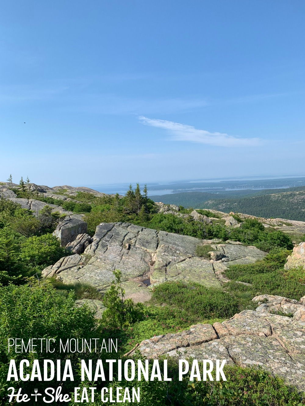 landscape photo of a rocky top mountain with the ocean in the distance in Acadia National Park