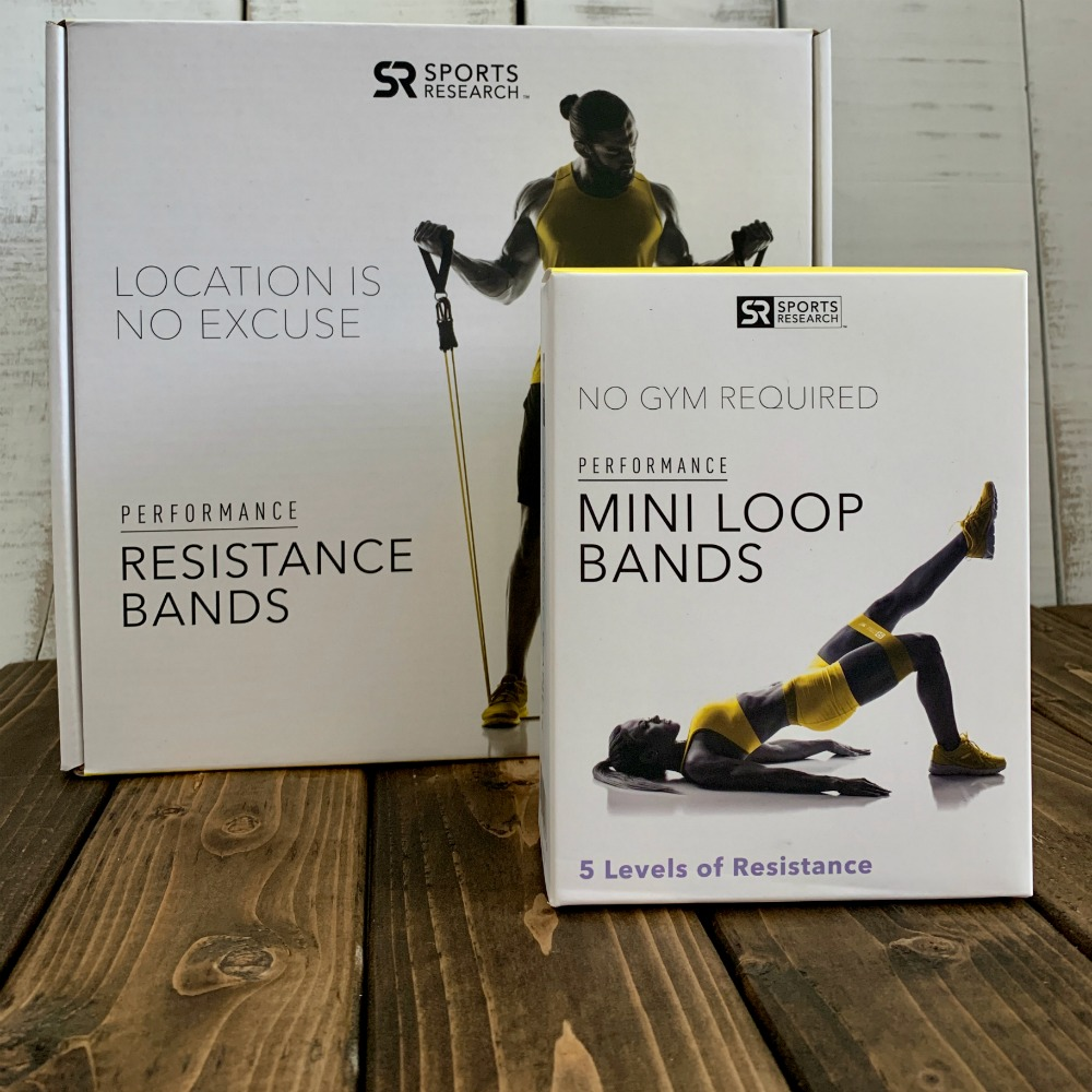 mini loop bands box and resistance band box on a wooden tabletop