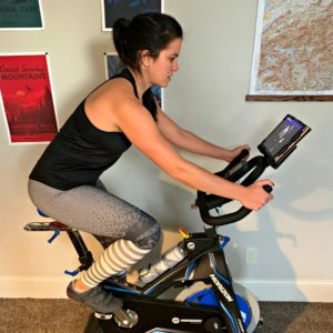 female using a Horizon indoor cycle