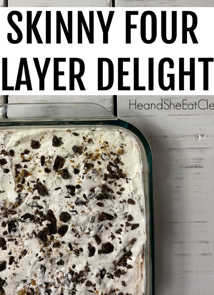 white Pyrex dish of four layer dessert with cookie crumbs & chocolate chips on top placed on a white tabletop