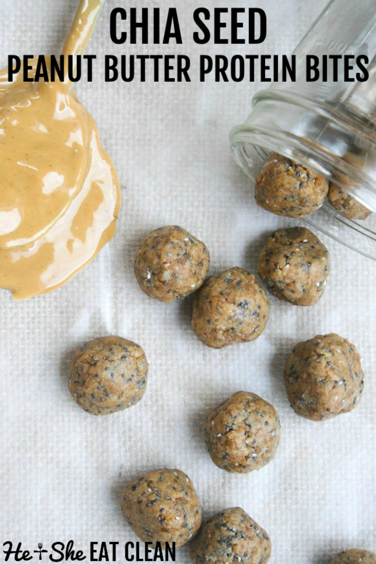 6 protein bites spilled out of a glass jar with peanut butter