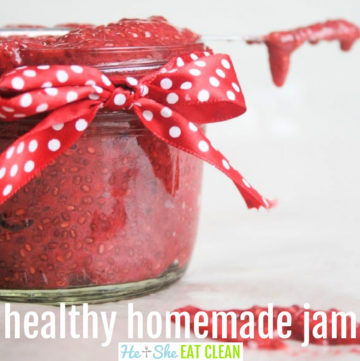 glass jar of red jam with red polka dot bow and a knife across the top of the jar