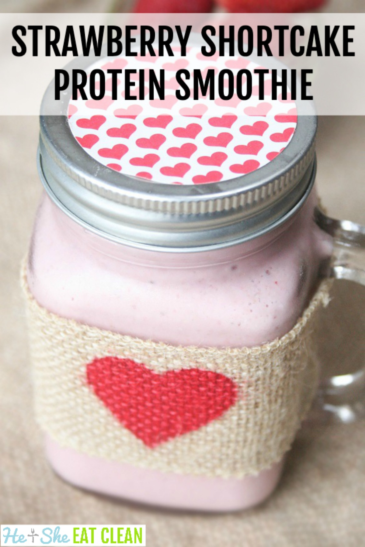 mason jar with lid filled with a pink protein shake - flavor is Strawberry Shortcake