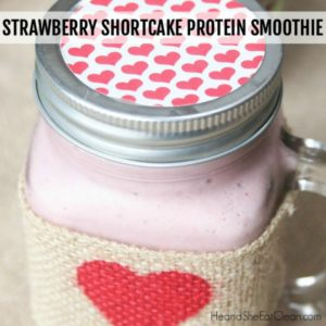 mason jar with lid filled with a pink protein shake - flavor is Strawberry Shortcake square image