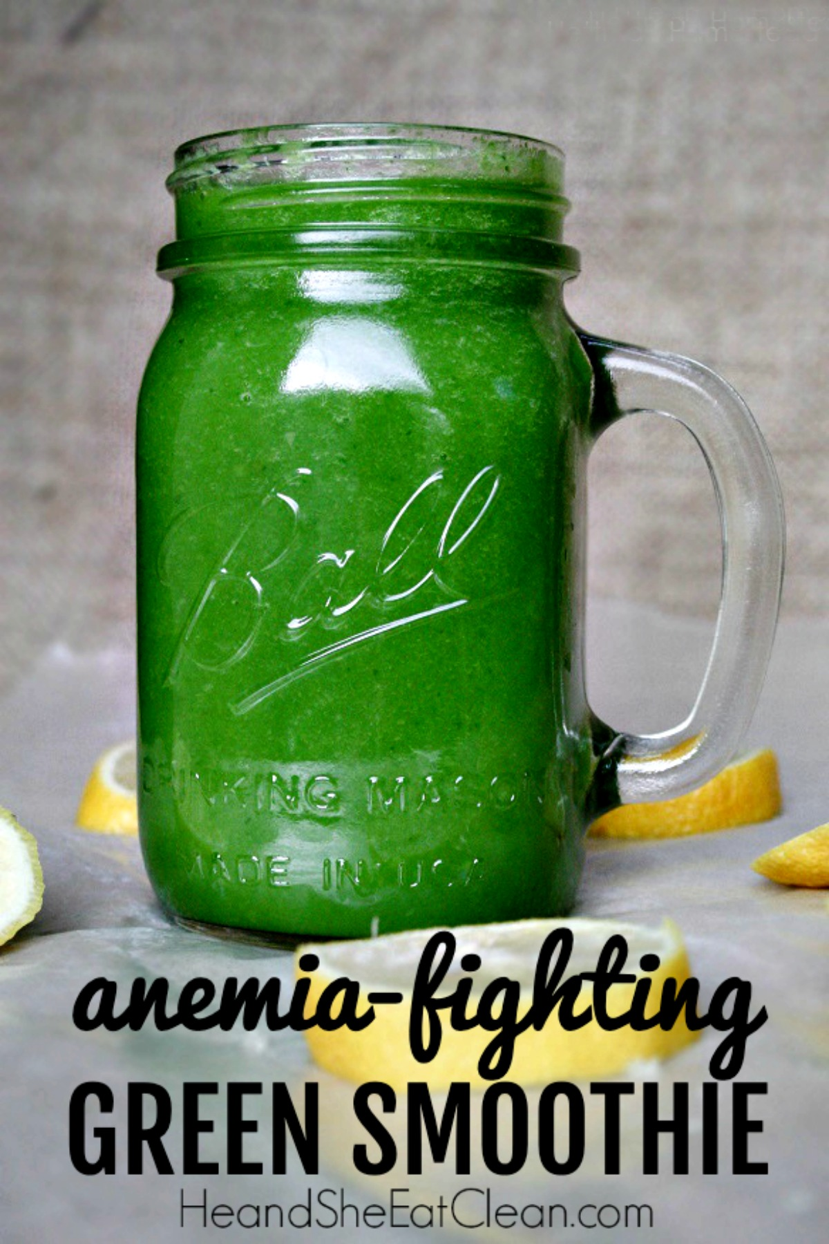 green smoothie in a clear glass jar with lemons