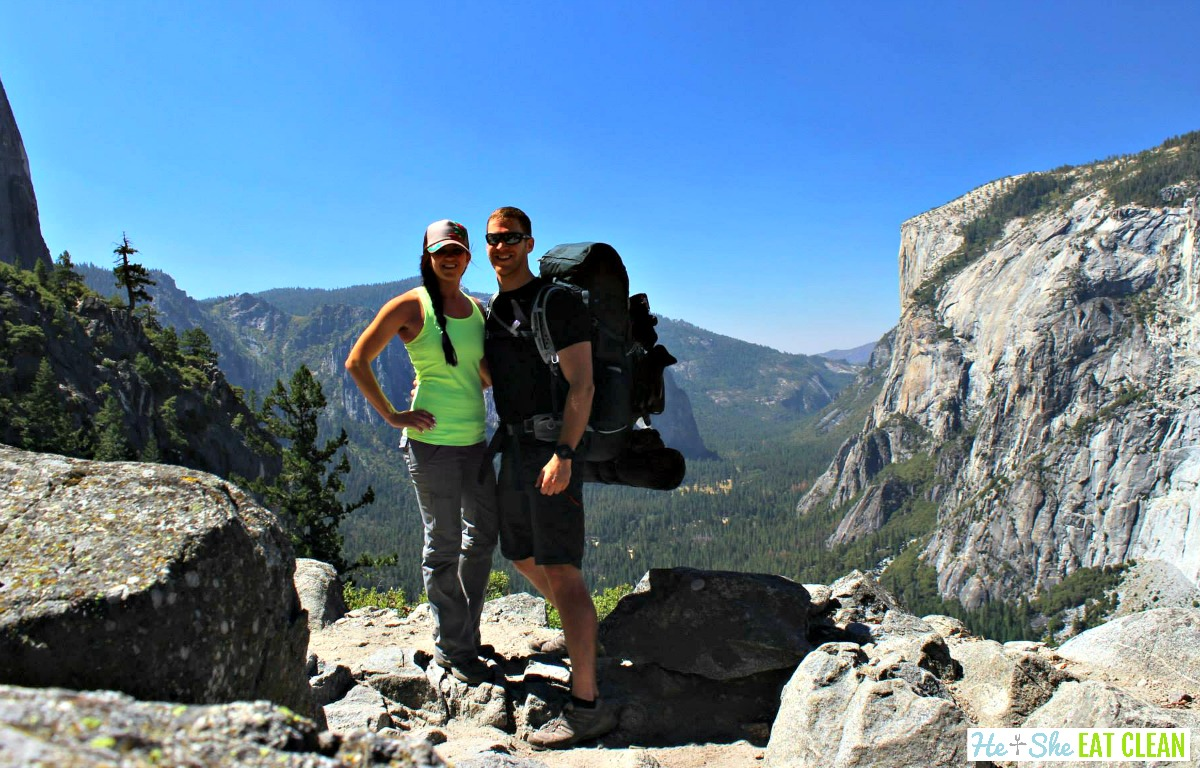 male and female backpacker standing on the 4 mile trail in Yosemite National Park