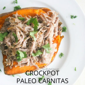 white plate filled with pulled pork on top of a sweet potato