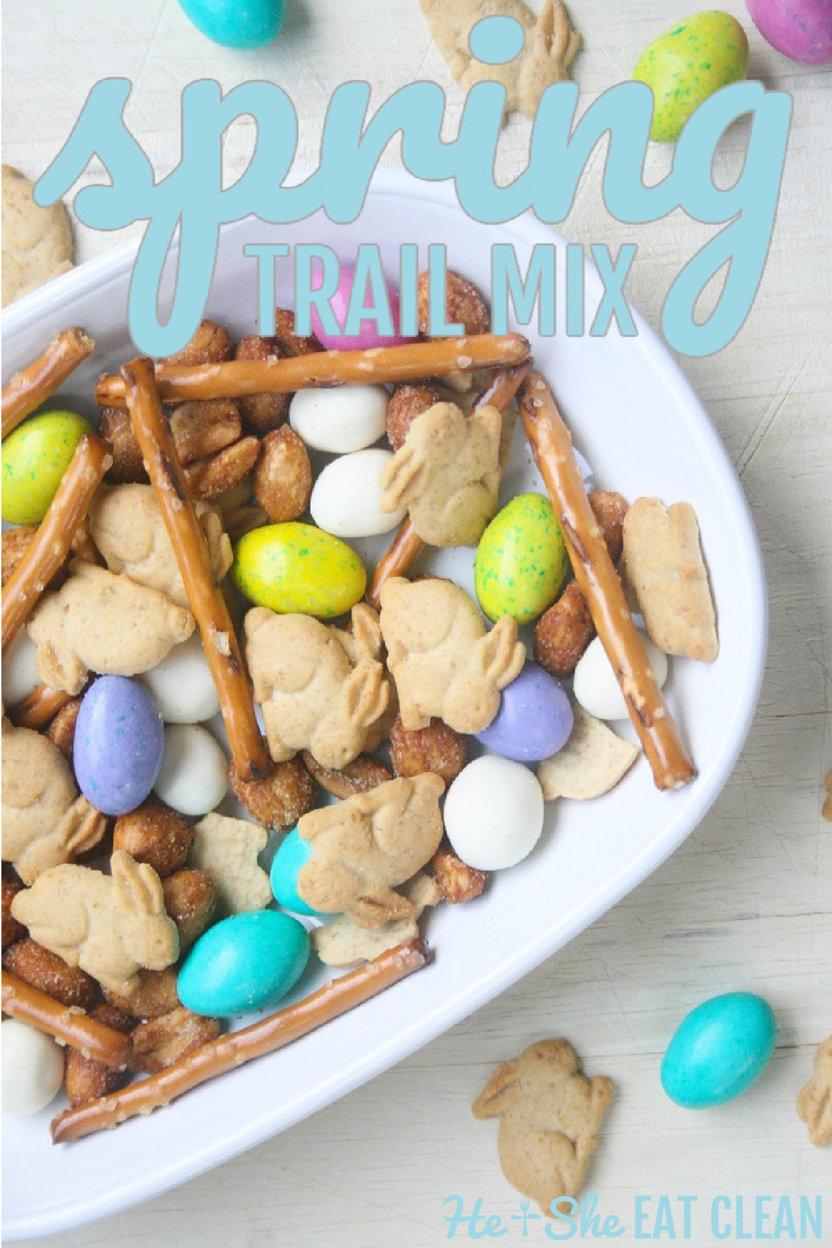 white bowl filled with Spring Trail Mix of chocolate candy, pretzels, yogurt raisins, and bunny crackers