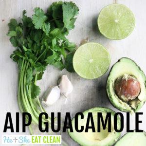 ingredients for guacamole on a white countertop (avocado sliced open, lime, cilantro, garlic)